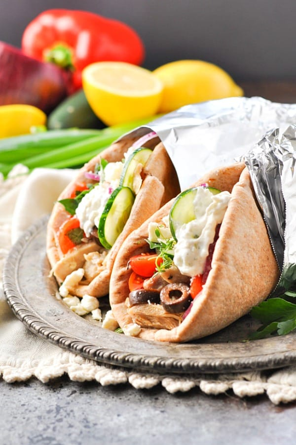 Crock Pot Greek Chicken Gyros with Tzatziki sauce and fresh vegetables