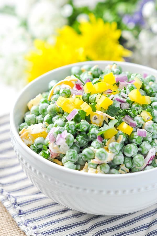 Close up front shot of half a bowl of southern pea salad