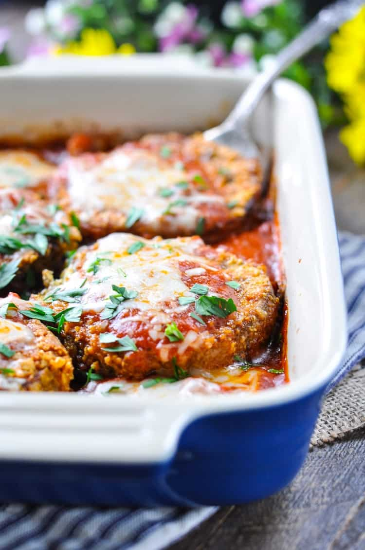 Baked eggplant parmesan garnished with fresh parsley