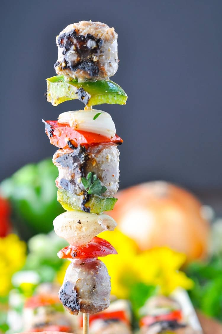 Italian sausage kabobs on a wooden skewer