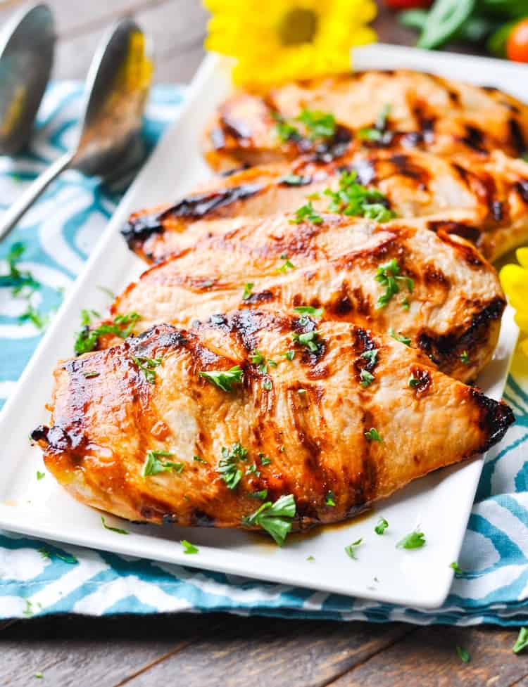 Season chicken in a mixture of herbs, salt and pepper, and the most fundamental ingredient: olive oil. Olive oil not only adds flavour to chicken breasts, it also adds moisture AND help your seasonings stick to the breast while avoiding chicken sticking to the bottom of your baking dish.