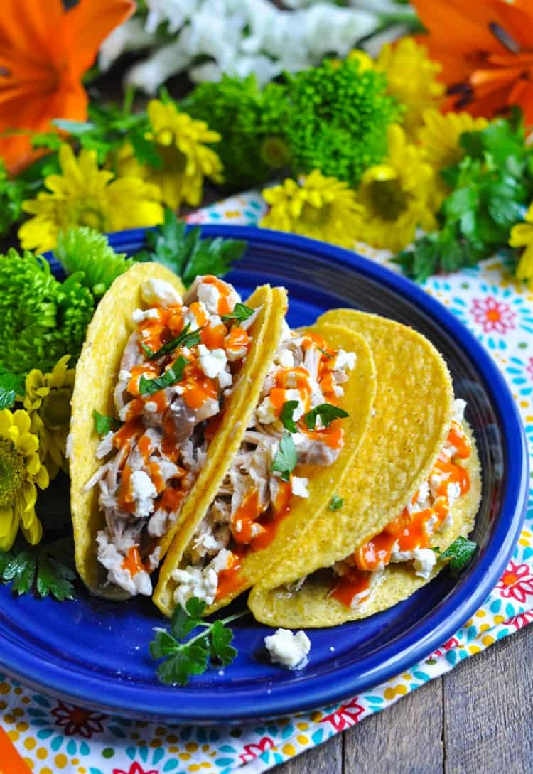 These Slow Cooker Buffalo Ranch Chicken Tacos are an easy dinner with 5 minutes of prep! Healthy Dinner Recipes | Chicken Breast Recipes | Slow Cooker Chicken Dinner #chicken #slowcooker #dinner