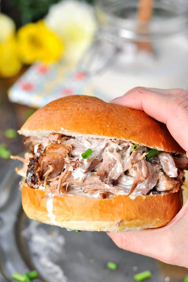 Close up shot of crock pot pulled pork sandwich