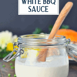 Alabama white barbecue sauce in a glass jar with wooden spoon