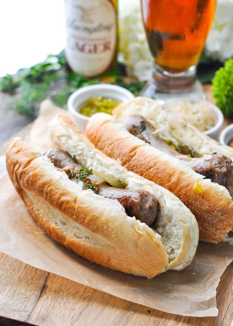 A close up of beer brats in buns