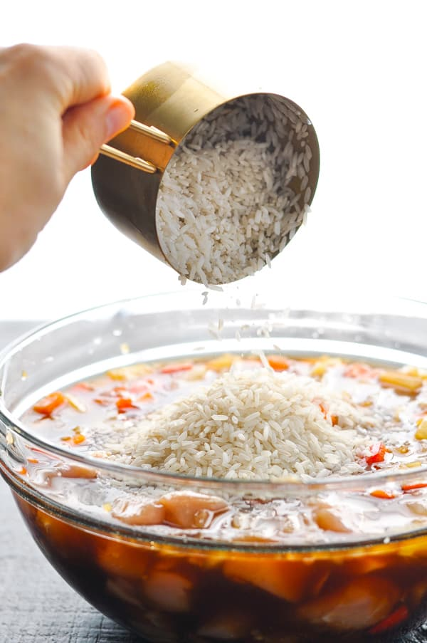 Pouring rice into mixing bowl