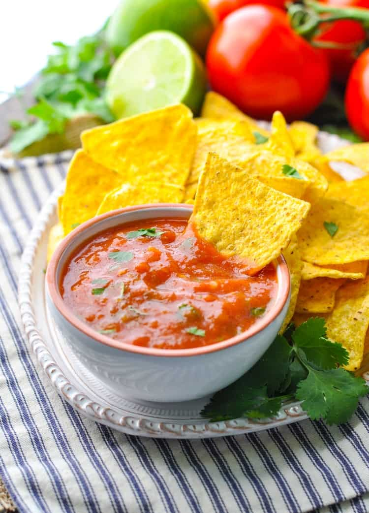 Homemade salsa in a small bowl with tortilla chips