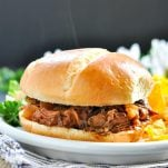 Crock Pot beef barbecue on a sandwich roll with text overlay