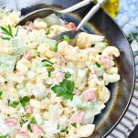 Close up image of old fashioned Southern Macaroni Salad in a ceramic serving bowl
