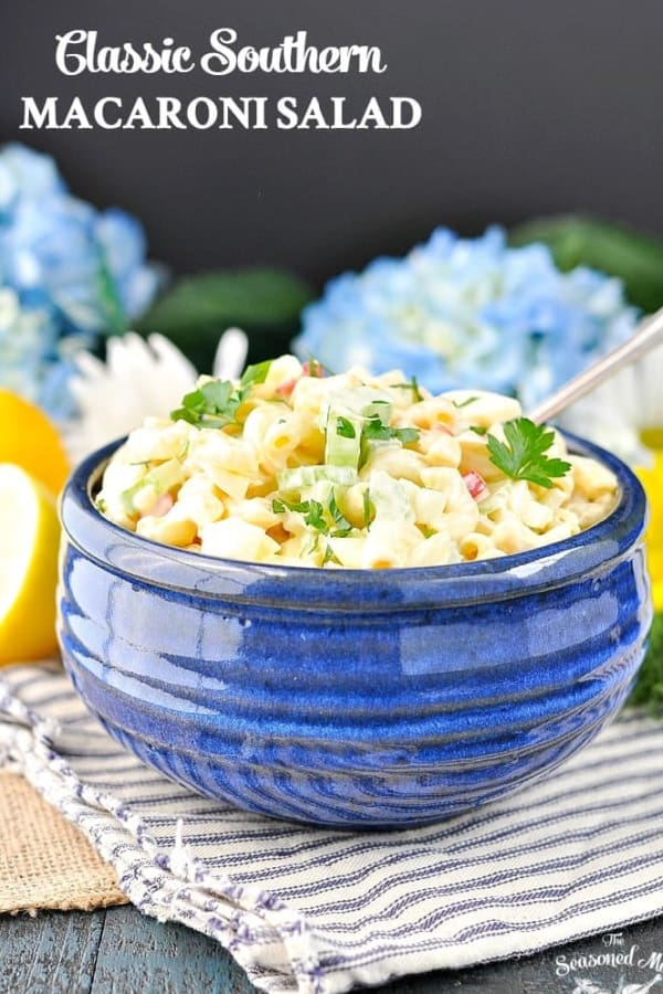 Front shot of a blue bowl full of the best macaroni salad recipe