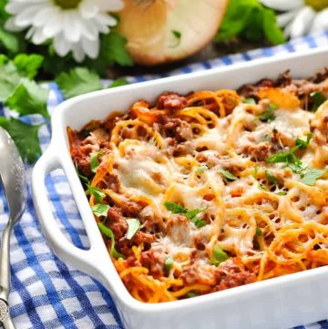 A side shot of baked spaghetti in a casserole dish