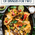 Beef nachos in a pan with text title box at top
