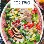 Overhead shot of chicken salad recipe dinner for two with text title overlay