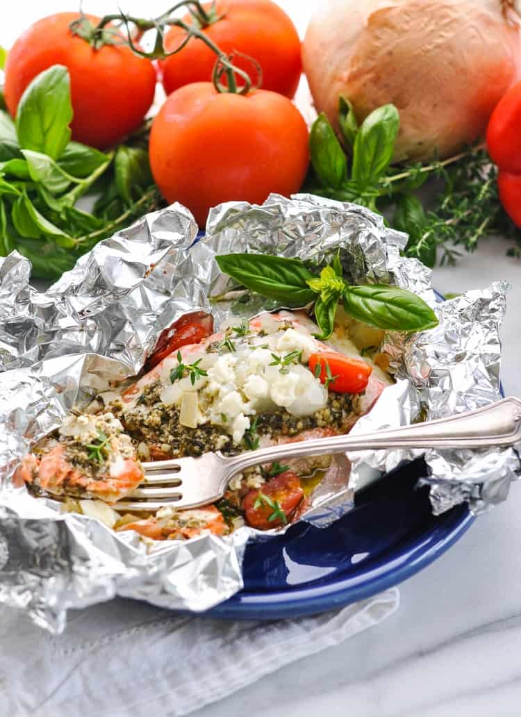 Mediterranean Salmon in Foil Packets sitting on a blue plate