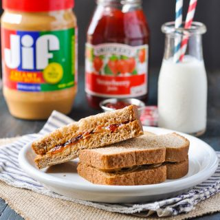 A peanut butter and jelly sandwich on a plate