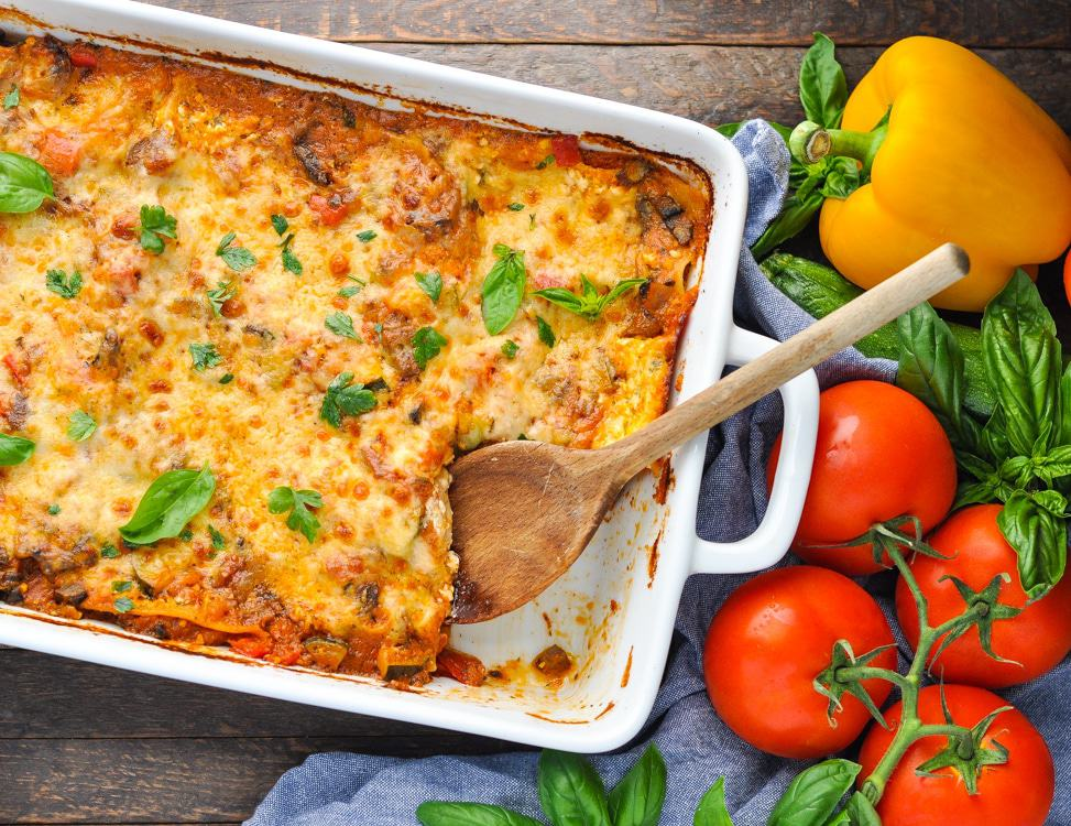 An overhead shot of an easy vegetable lasagna with melted cheese on top