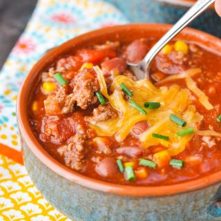 Spoon in a bowl of slow cooker chili
