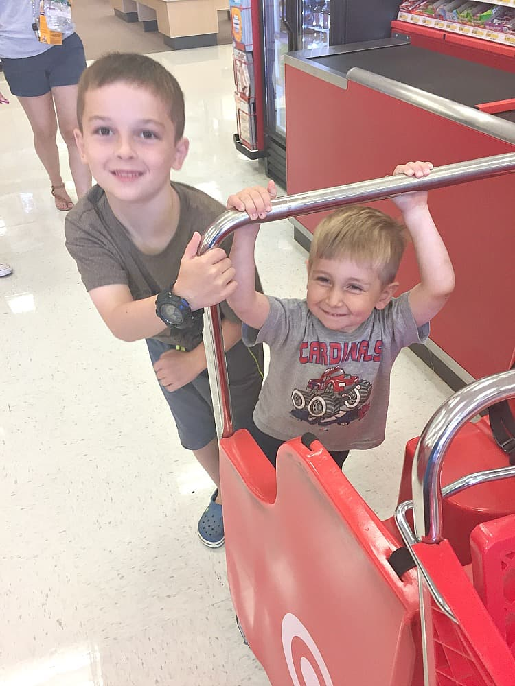 A photo of two boys in a supermarket