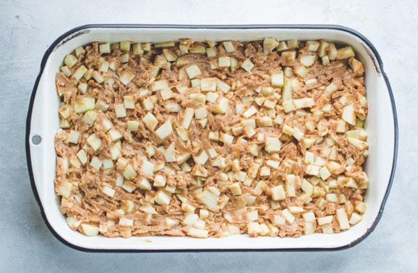 Process shot showing how to make caramel apple cake
