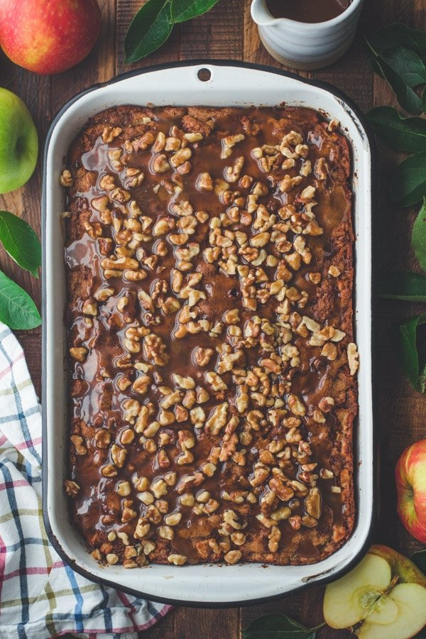 Overhead shot of old fashioned apple walnut cake on a wooden table