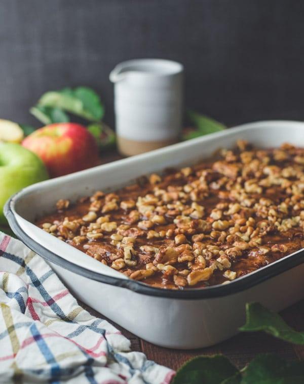 Side shot of a pan of fresh apple walnut cake