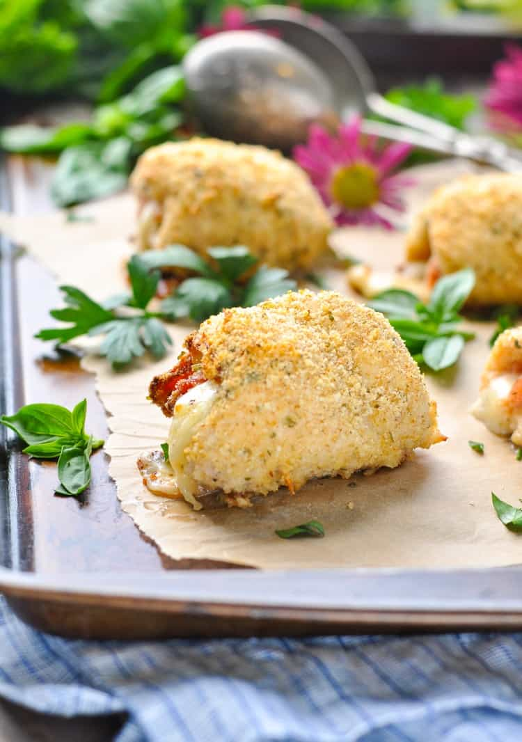 Stuffed chicken roll ups on a baking sheet