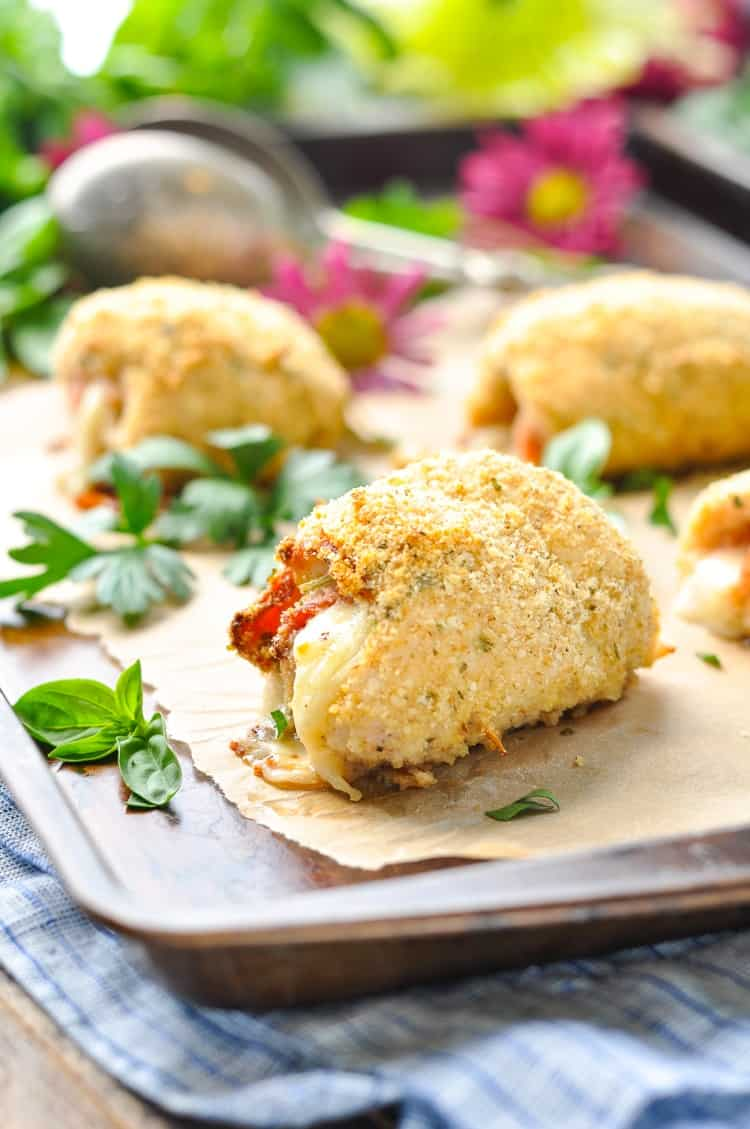 Italian stuffed chicken roll ups on a tray