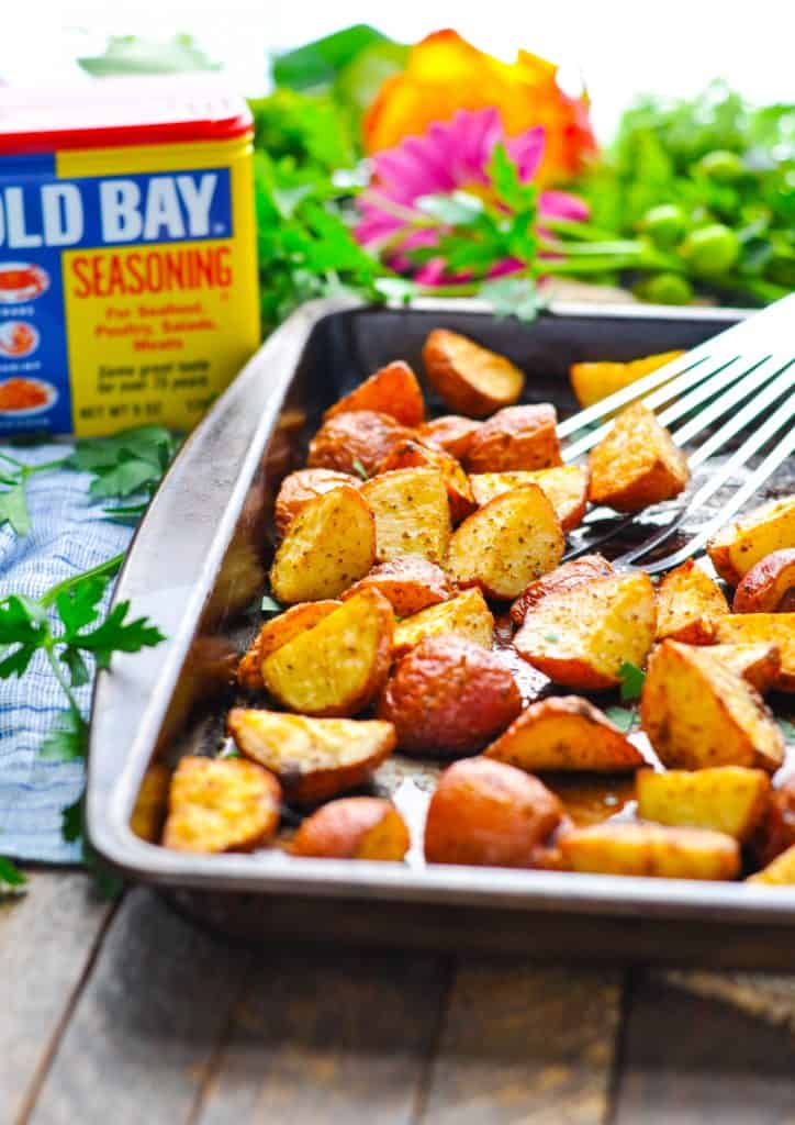 Side shot of a tray of crispy seasoned red potatoes