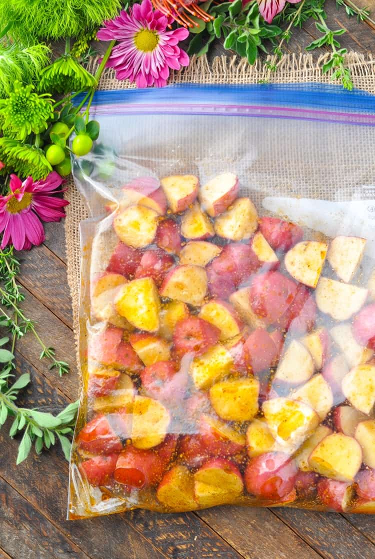 seasoned red potatoes in a plastic zipper bag