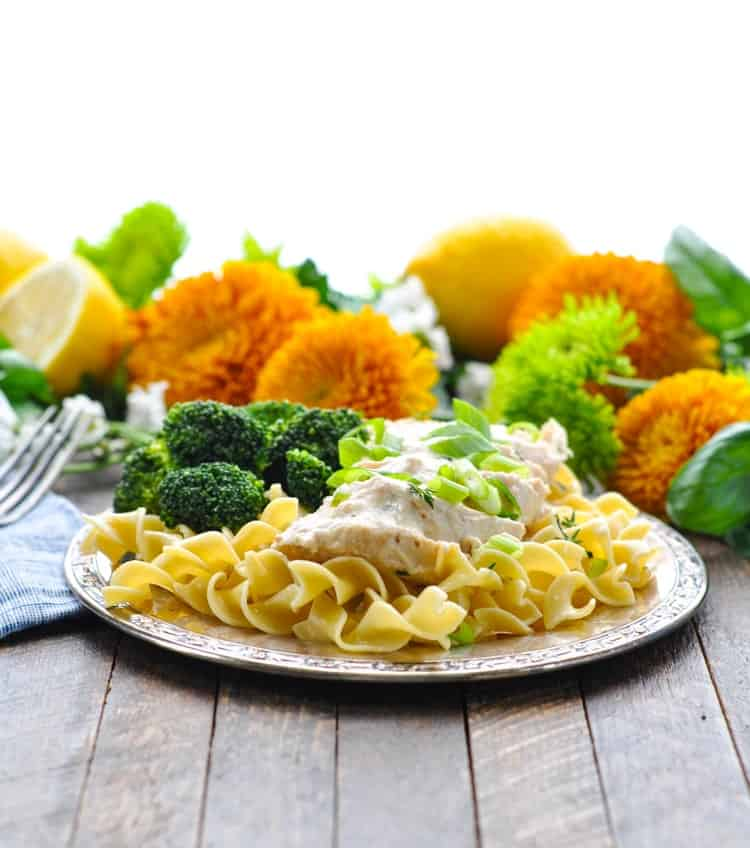 Cream of mushroom chicken on a plate with pasta and broccoli