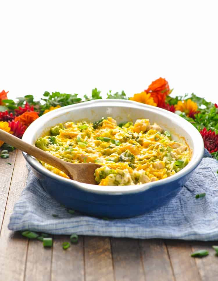 A chicken broccoli rice casserole in a blue dish