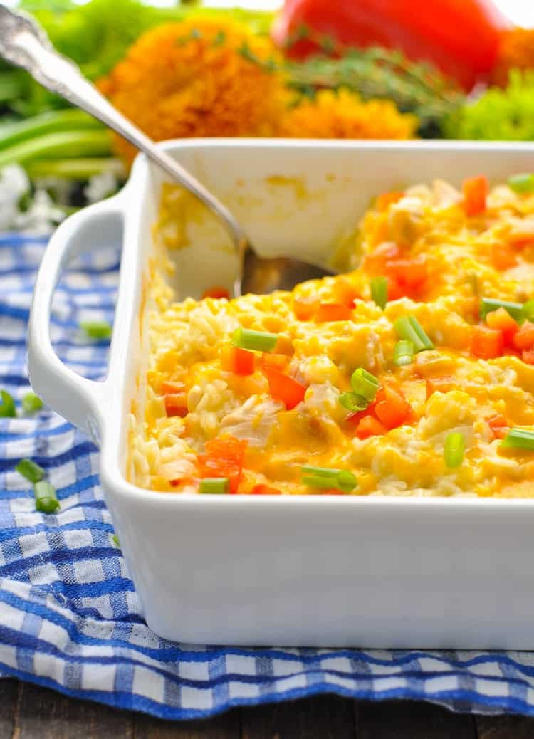 A close up of a fiesta chicken bake with a serving spoon
