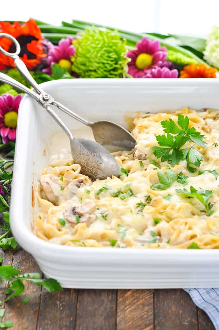 A close up of turkey tetrazzini topped with parsley