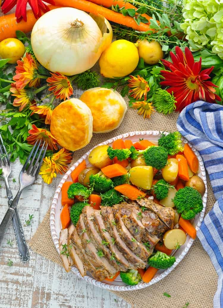 With just 10 minutes of prep, this Garlic & Herb Slow Cooker Pork and Vegetables is an easy and healthy dinner to suit your busiest days! Slow Cooker Recipes | Slow Cooker Recipes Healthy | Easy Dinner Recipe