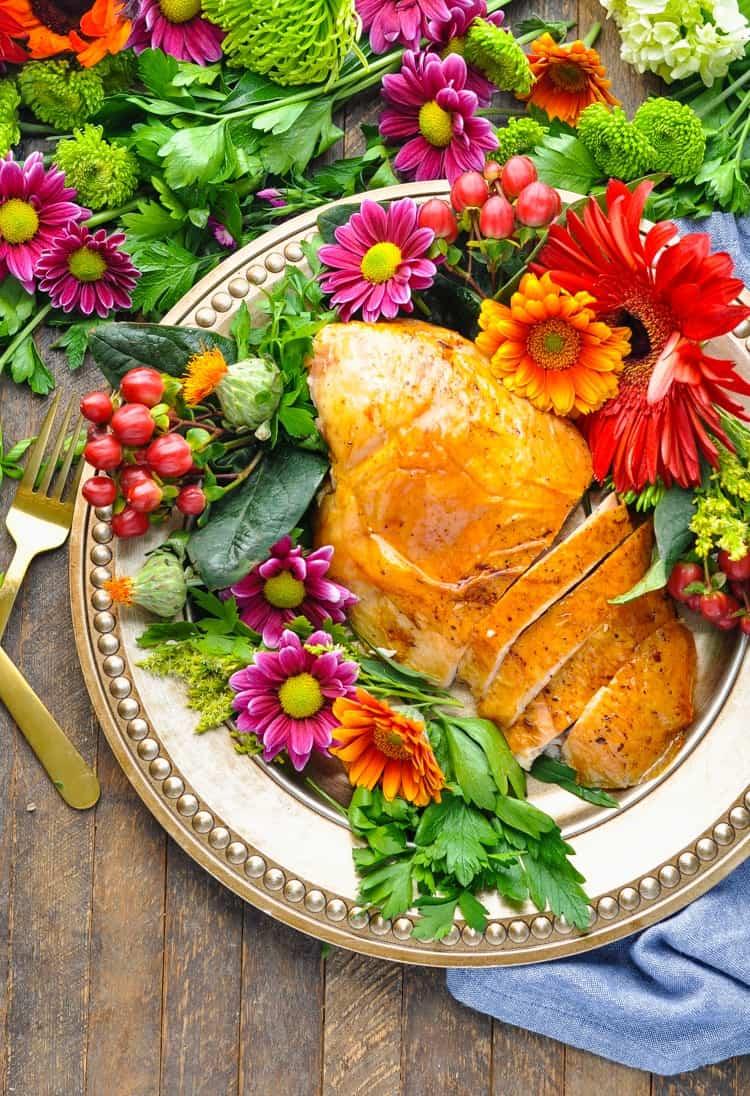 An overhead shot of a sliced roast turkey breast on a plate