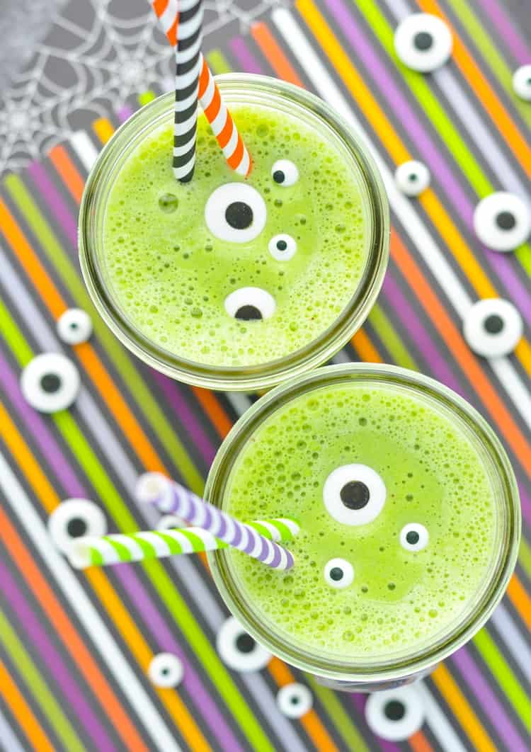 An overhead shot of two monster green smoothies topped with monster eye candy