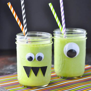 Monster green smoothies in two glass jars