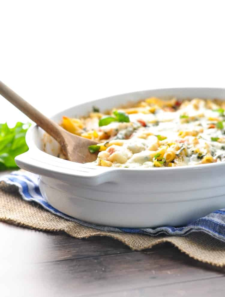 No boiling the pasta and no cooking the chicken -- this Dump-and-Bake Chicken Florentine Pasta is ready for the oven! Chicken Breast Recipes | Easy Dinner Recipes | Pasta Recipes | One Pot Meals #chicken #dinner #pasta #casserole