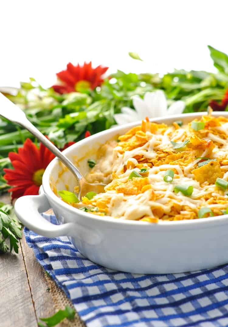 A cool ranch chicken casserole in a white baking dish