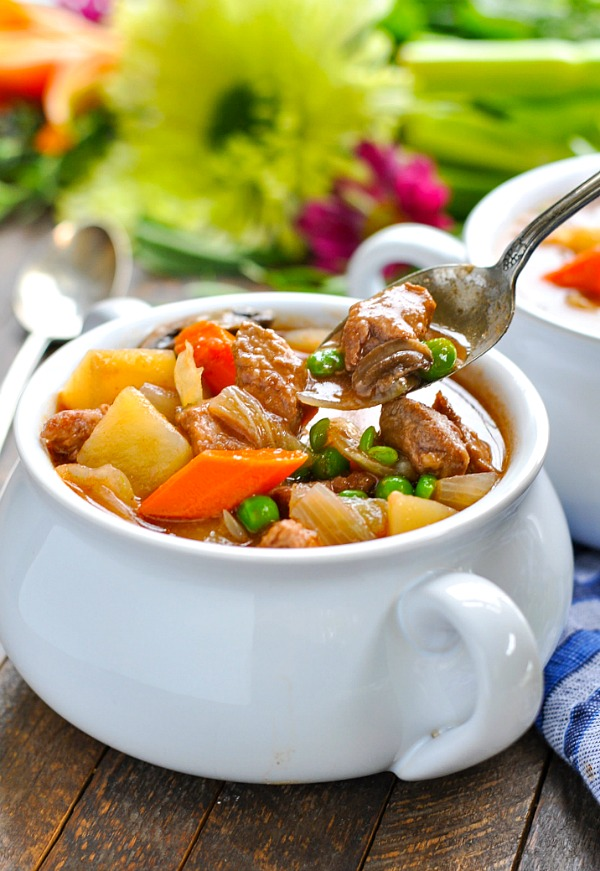 Close up shot of beef stew on a spoon