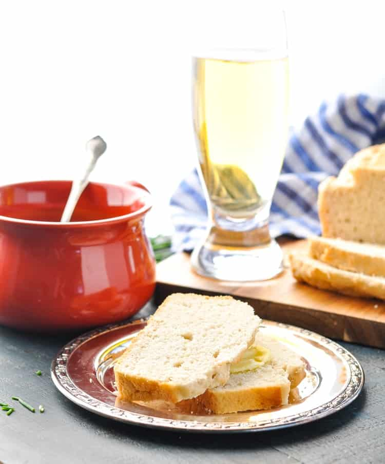 Two slices of beer bread on a silver plate