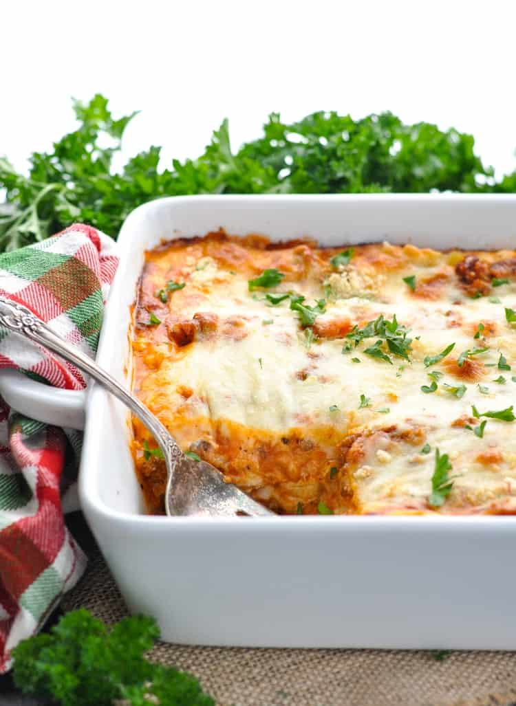Side view of a classic Italian lasagna recipe in a white casserole dish