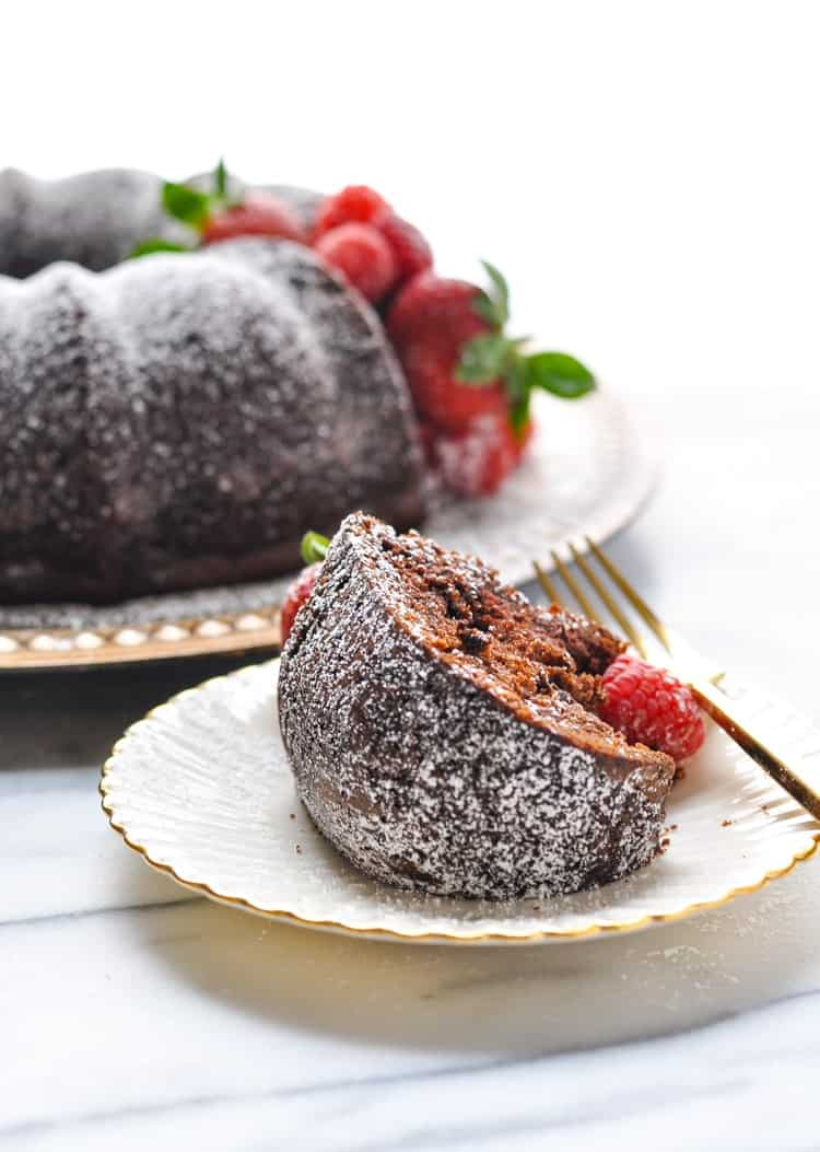 With a little bit of help from a boxed mix (plus a few secret ingredients), Claudia's Easy Triple Chocolate Cake is ready for the oven in about 10 minutes! Cake Mix Recipes | Bundt Cake Recipes | Easy Dessert Recipes #chocolate #cake #cakemix #dessert
