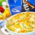 Cool Ranch Chicken Casserole in a white baking dish with a serving spoon