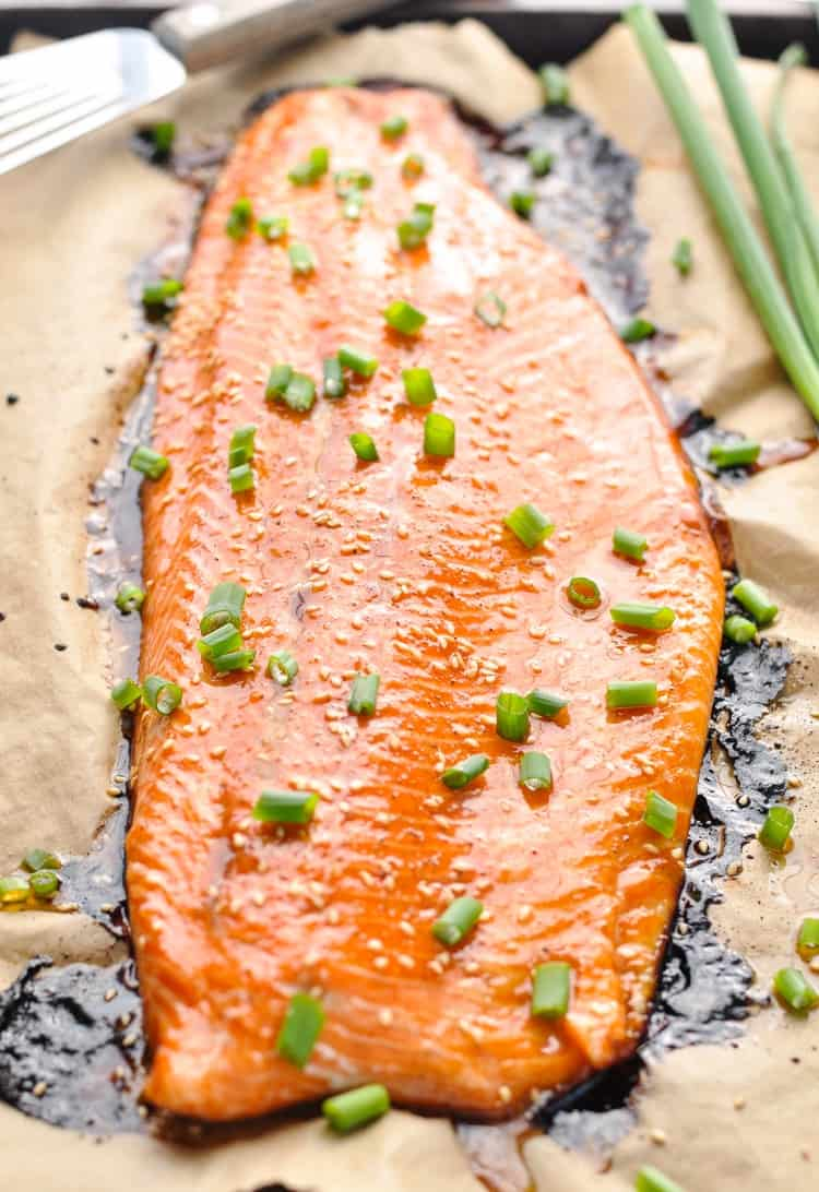 Vertical image of a large salmon baked