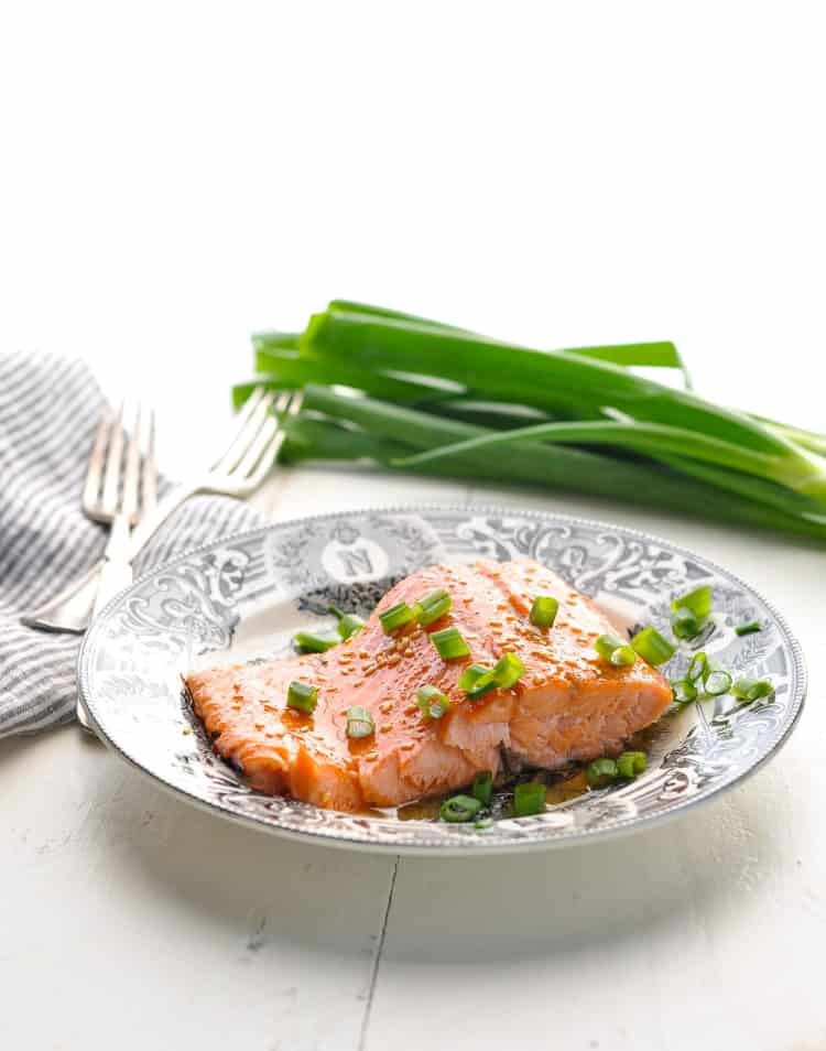 Photo of a piece of baked salmon on a plate.