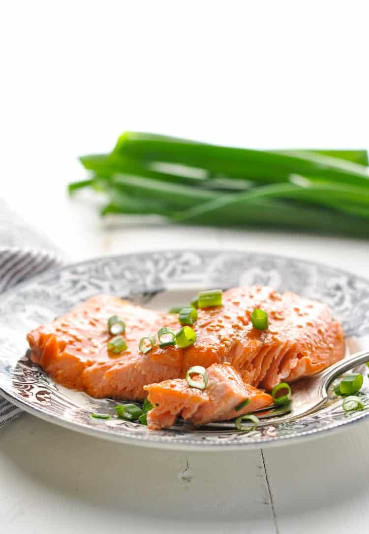 Photo of baked salmon on a plate with fork.
