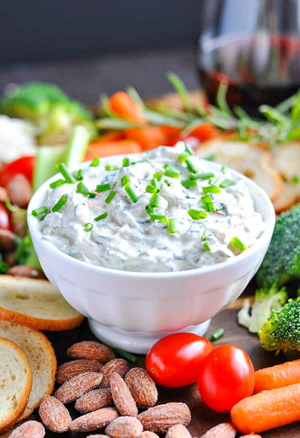 Creamy spinach dip in a white bowl
