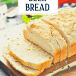 Sliced loaf of no yeast beer bread with text title overlay