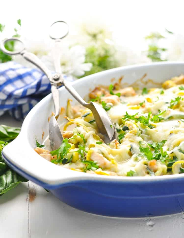 Bright and beautiful image of chicken and zucchini noodles in casserole dish